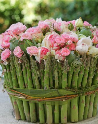 arrangement of pink roses and asparagus spears