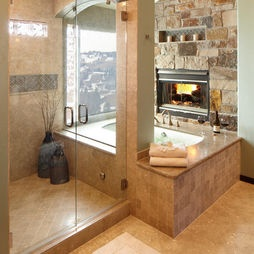 Fireplace in a bathroom. Yes please! I would love to have the fire place be part of the bedroom too.