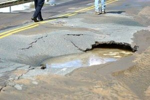 On Puritan Road in Swampscott, Massachusetts, a large sink hole formed, an oval about 10 feet long and five feet