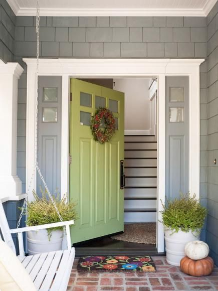 The front door is the perfect spot for a jolt of color that might otherwise overwhelm your home. More ways to boost your home's curb appeal: www.midwestliving...