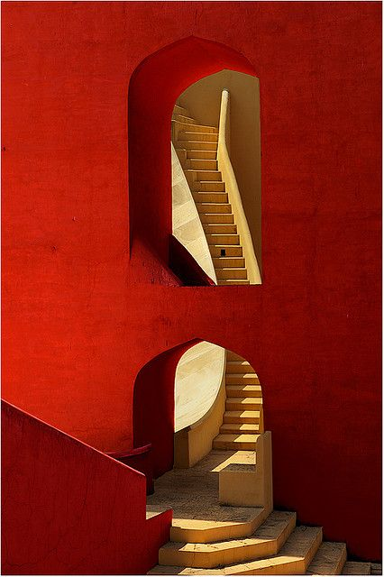 Red wall stone staircase