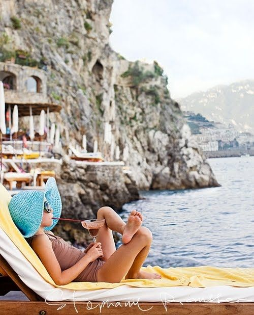 almafi coast.  Oh my, can I be her...what a life & she's all of what - 10?