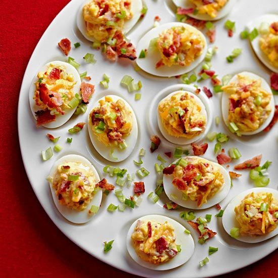 Spice up classic deviled egg for your Easter brunch with sharp cheddar cheese, bacon, and green onions. More Easter recipes: www.bhg.com/...