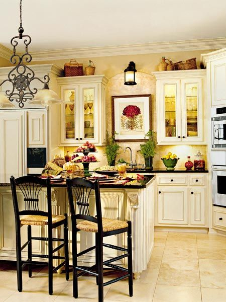 cream kitchen with black countertops