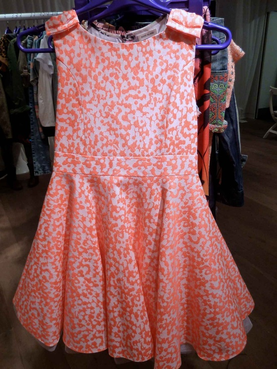The flouro trend in a vibrant orange swirl at River Island kids fashion for summer 2013