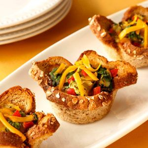 """Veggie Bread Cups   From Pepperidge Farm   These bread cups are actually a creative way to make individual veggie """"quiches"""". They use light, extra fiber bread for the crust and are packed with colorful vegetables and low-fat cheese. They're great for breakfast, brunch or as appetizers."""