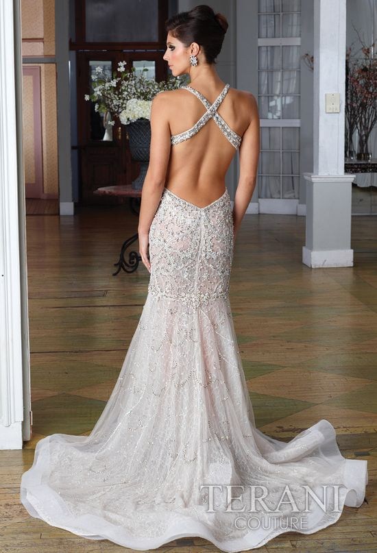 Fitted backless wedding dress with criss-cross shoulder straps. Look at all the beading and sequin detail! Perfection.