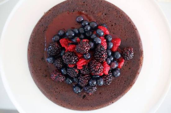 flourless dark chocolate cake with fresh berries on top