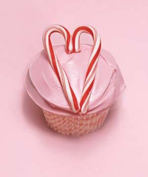 Use mini candy canes to create hearts on pink cupcakes.