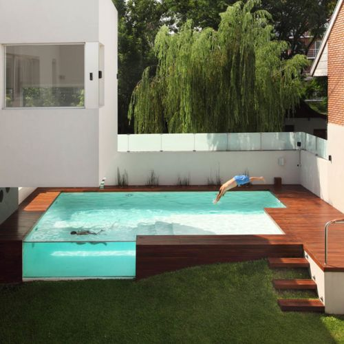 I love the idea of a glass wall on a pool, a spa and also a fish pond, maybe most so for the pond.