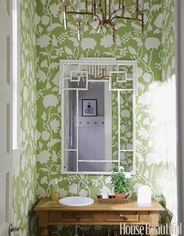 Floral green wallpaper brighten this Hamptons bathroom. Designed by Meg Braff. housebeautiful.com #green_bathroom #geometric_mirror #decorating_ideas #small_spaces
