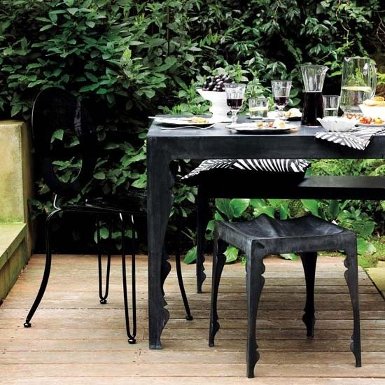 outdoor dining. black table and chairs.