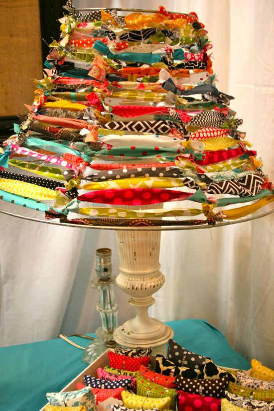 strip an old metal lampshade and tie scraps of fabric around the frame – so cute
