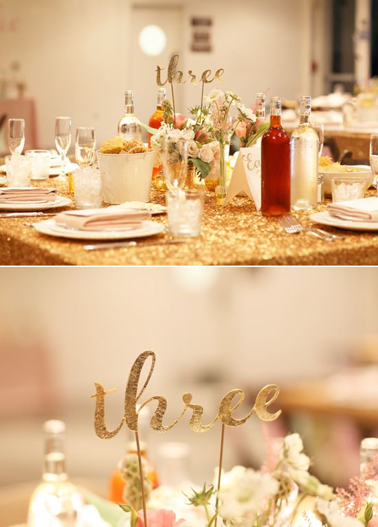 paper cut-out table numbers and gold sparkle linens | Photo by Kimberly Genevieve