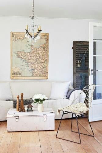 Boho chic living room. Love the framed map and use of the trunk as a coffee table