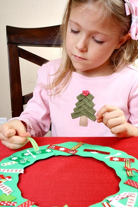 Wreath #Craft for Kids, love the tree on her shirt, could be fun to recreate using strips of paper!