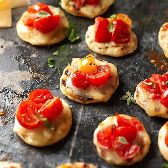 Serve these bite-sized pizzas made from frozen bread dough and roasted cherry tomatoes. More tasty party appetizers: www.bhg.com/...