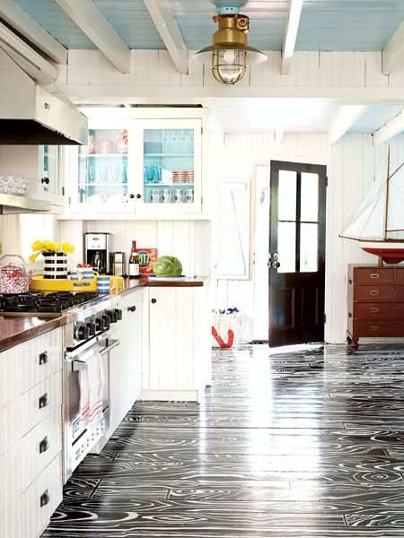 Funky Coastal Kitchen ~ LOVE the ceilings! A black-and-white faux bois treatment looks almost too pretty to walk on. The hand-painted pattern takes the traditional wood floors from standard to striking. A clear coat of varnish on the mahogany countertops produces a nautical look that wears well.