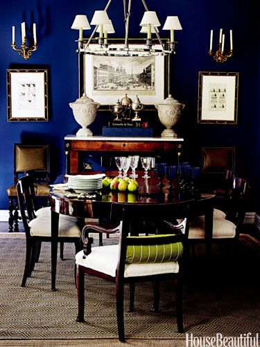 Masculine Dining Room Designer Mary McDonald created a glamorous bachelor's house in Los Angeles, steeped in drama and elegance. Dining room walls are Frank Blue by Sherwin-Williams — a conservative, masculine color that's sexy in this context. The mahogany table and chairs are 18th-century Regency; diamond-weave rug is from Dash & Albert.