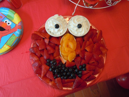 Fruit platter idea for the party using strawberries, mandarin oranges, blueberries and either whipped cream, fruit dip, or yogurt.  Too cute! I am going to do this for Ava's 2nd Birthday Elmo themed!