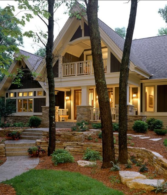 Covered upstairs porch, columns.  What a charming home! I have always loved craftsman style.