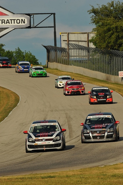 Two APR VW GTIs lead the pack during the Continental Tire Sports Car Challenge Series race at Road America