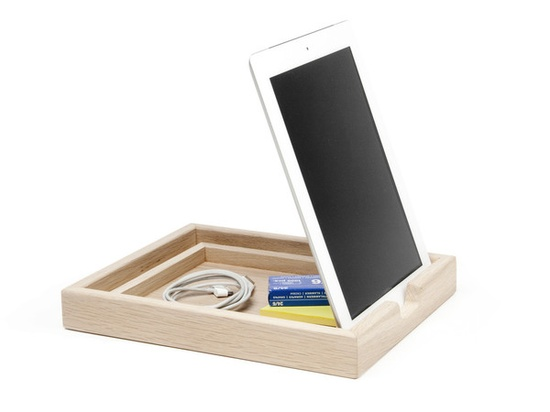 Elegant tray with numerous docking possiblities for digital devices.   Compatible with iPads, iPad 2 and many other devices. $100