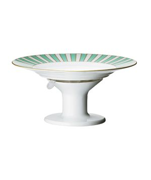 Serve It Up -- This 4.5-inch-tall porcelain pedestal turns any standard plate into a cake stand; a curiously strong suction cup holds everything in place.