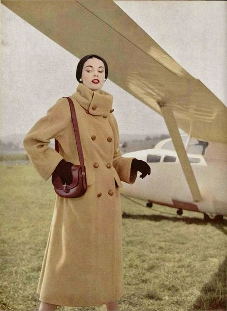 Nothing helps beat out icy winds - be they winter or caused by airplane propellers - better than a classic winter weight camel coat. #vintage #1950s #fashion #coat