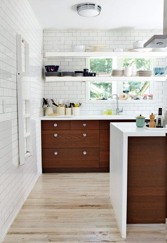 Kitchen with open shelving and subway tile for days