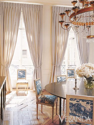 Subtle Toile: A discreet dose on seat backs and cushions enlivens a neutral dining room in a Paris pied-à-terre.