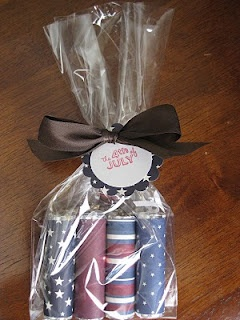 Cute idea, patriotic scrapbook paper wrapped around lifesavers for a July Visiti