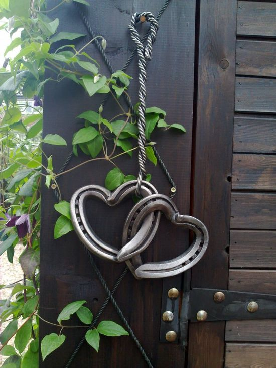 Old horseshoes made into hearts and hung