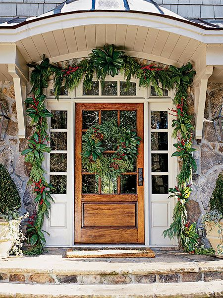 Beautiful entry way decorated with greenery and magnolia leaves