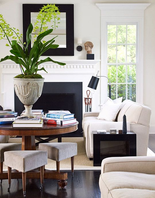 Clean lines and a contrasting palette brings mod sophistication to this living room - Traditional Home®