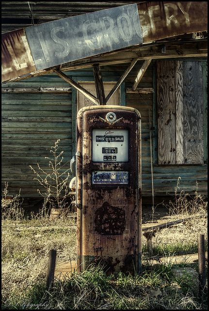 Abandoned store with old gas pump