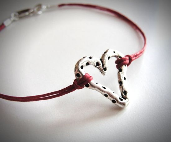 Sterling Dotted Heart on red linen bracelet. $20 from JewelryByMaeBee on Etsy.