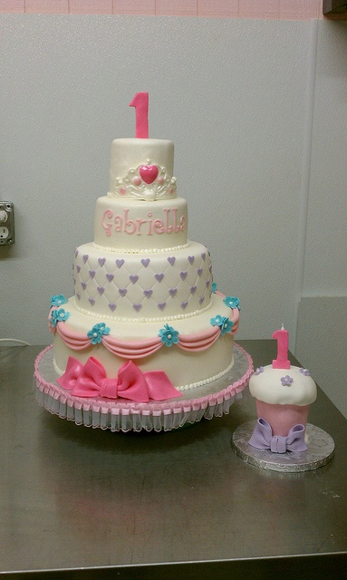 Princess 1st birthday theme cake and matching oversized smash cupcake by Little