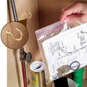 Don't file away the manuals for your kitchen & bath fixtures. Instead, slip them into a zip-top plastic bag & hang the bag in the cabinet under the sink. They'll always be right where you need them...especially nice for warranty info w/copy of receipt.  Toss in paint samples & spare cabinet hardware too.