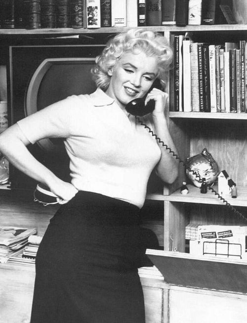 1955: Marilyn Monroe using the telephone on the day of her 'Person to Person' interview.