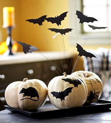 Halloween Decorating.  Use simple black paper silhouettes and white pumpkins. Bats, spiders, rats, or whatever creepy creature you can stand. :)