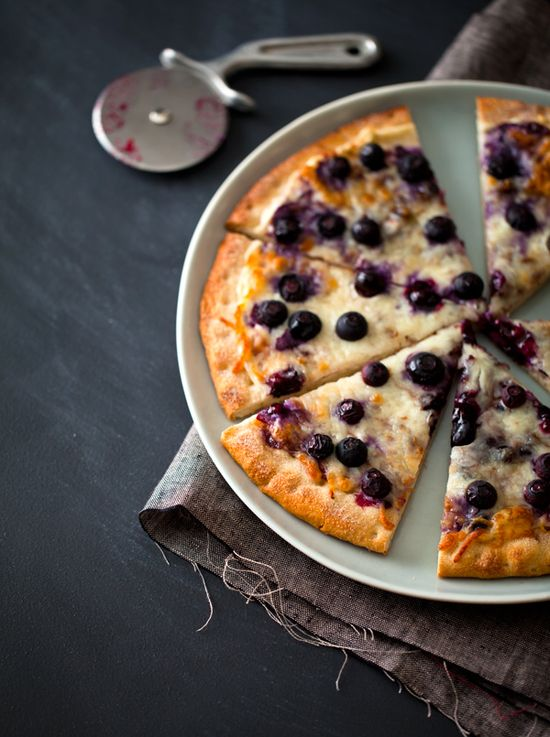 "Blueberry Dessert Pizza  Makes 1    Ingredients:  1 12"" ready-made pizza crust  4 ounces cream cheese, softened  1 teaspoon cinnamon  1/3 cup blueberry jam  1 cup grated part-skim mozzarella cheese  1 cup fresh blueberries"