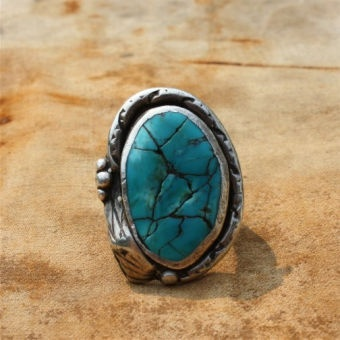 What a unique piece of jewelry. I love turquoise!