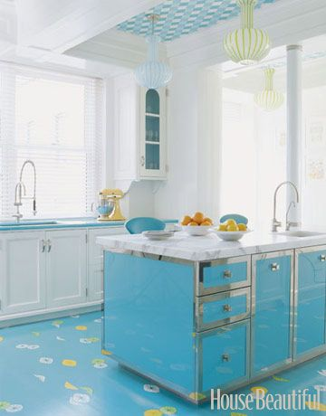 Designers William Diamond and Anthony Baratta mixed old and new in this colorful kitchen. The Italian lamps are circa 1960, and the island is custom-made. Accessorize with classic appliances, like a colorful KitchenAid mixer.