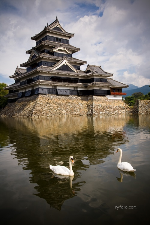Matsumoto Castle, one of four castles designated as 'National Treasures of #Japan' and the oldest #castle donjon remaining in Japan. Construction began in 1592 of the elegant black and white structure with its three turrets. Because of the elegant black walls, #Matsumoto Castle is sometimes called 'Crow Castle'. The narrow wooden windows, once used by archers and gunmen, provide amazing views of the Japanese Alps, Matsumoto City and the koi and swans circling in the moat below.``