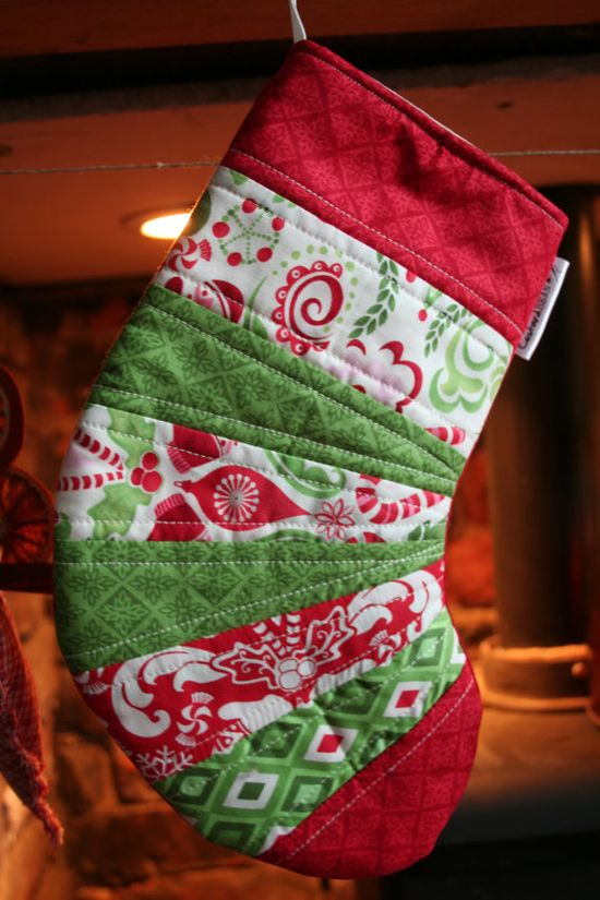 Handmade Quilted Christmas Stocking. Usually I like long stockings, but I'm actually kind of liking this short and fat pattern