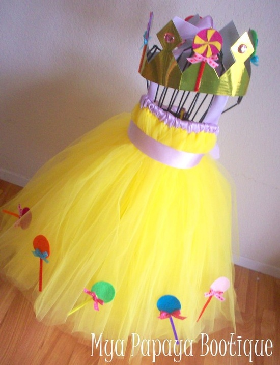 Candy Land's Princess Lolly costume. Would be easy to DIY. She's pink in our game, though.