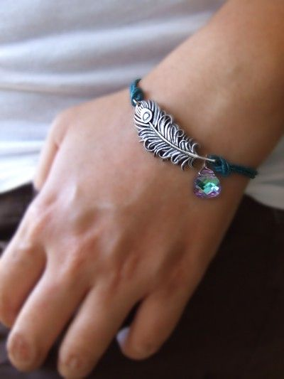Peacock bracelet. I have that feather charm