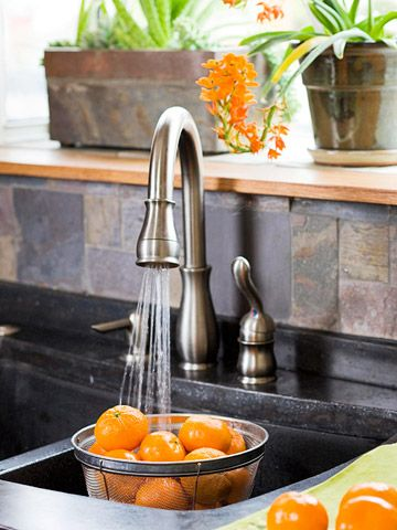 love the faucet and backsplash, too.  Wish I had a window in my kitchen, though!