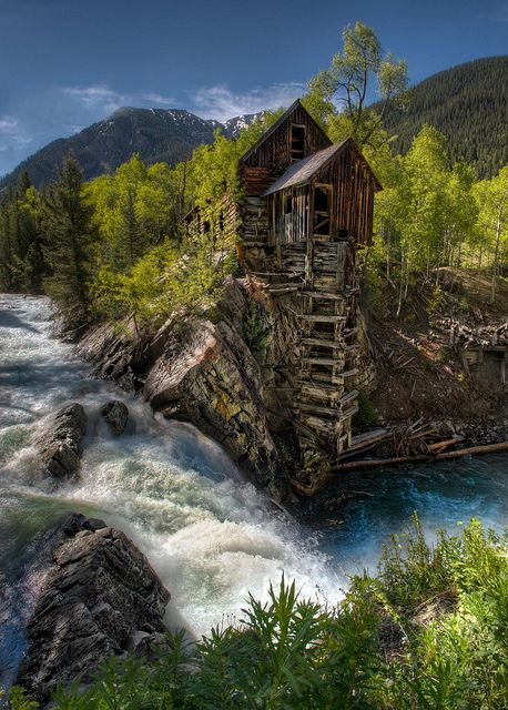 The Old Crystal Mill sits abandoned in Colorado.  It was operational from 1893-1917.  Now it is a famous Colorado landmark. Beautiful photo!